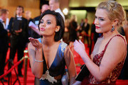Miranda Tapsell (L) blows a kiss as she arrives at the 57th Annual Logie Awards at Crown Palladium on May 3, 2015 in Melbourne, Australia.