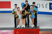(L-R) Second place winner Cong Han and Wenjing Sui of China, first place winner Meagan Duhamel and Eric Radford of Canada, third place winner Qing Pang and Jian Tong of China pose for the photo after the metal ceremony of Pairs Free Skating of the 2015 ISU World Figure Skating Championships at Shanghai Oriental Sports Center March 26, 2015 in Shanghai, China.