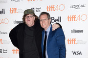 """Filmmaker Michael Moore (L) and TIFF moderator Thom Powers attend the """"Where to Invade Next"""" premiere during the 2015 Toronto International Film Festival at the Princess of Wales Theatre on September 10, 2015 in Toronto, Canada."""