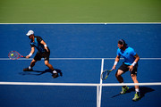 Sam Groth and Lleyton Hewitt of Australia return a shot against Colin Fleming of Great Britain and Treat Huey of the Philippines during their Men's Doubles Second Round match on Day Six of the 2015 US Open at the USTA Billie Jean King National Tennis Center on September 5, 2015 in the Flushing neighborhood of the Queens borough of New York City.