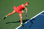 Sabine Lisicki of Germany serves to Simona Halep of Romania during their Women's Singles Fourth Round match on Day Eight of the 2015 US Open at the USTA Billie Jean King National Tennis Center on September 7, 2015 in the Flushing neighborhood of the Queens borough of New York City.