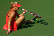 Sabine Lisicki of Germany sits on the ground after a play against Simona Halep of Romania during their Women's Singles Fourth Round match on Day Eight of the 2015 US Open at the USTA Billie Jean King National Tennis Center on September 7, 2015 in the Flushing neighborhood of the Queens borough of New York City.