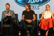 (L-R) Host Ryan Seacrest, musician/judge Keith Urban and singer/actress/judge Jennifer Lopez speak onstage during the 'American Idol' panel discussion at the FOX portion of the 2015 Winter TCA Tour at the Langham Hotel on January 17, 2015 in Pasadena, California.