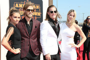 Singers Brian Kelley (2nd L) and Tyler Hubbard (2nd R) of Florida Georgia Line with Brittney Marie Cole (L) and Hayley Stommel (R) attend the 2016 American Country Countdown Awards at The Forum on May 1, 2016 in Inglewood, California.