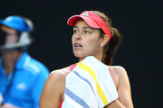 Ana Ivanovic of Serbia looks towards her players box as her coach Nigel Sears fell over in the stands in her third round match against Madison Keys of the United States during day six of the 2016 Australian Open at Melbourne Park on January 23, 2016 in Melbourne, Australia.