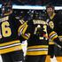 Hal Gill #75 of the Boston Bruins, right, and Rick Middleton #16, left congratulate Sergei Samsonov #14 after he scored against the Montreal Canadiens during the 2016 Bridgestone NHL Winter Classic  Alumni Game at Gillette Stadium on December 31, 2015 in Foxboro, Massachusetts.