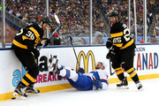 Andrei Markov #79 of the Montreal Canadiens falls to the ice as Zac Rinaldo #36 and Max Talbot #25 of the Boston Bruins skate in the first period during the 2016 Bridgestone NHL Winter Classic at Gillette Stadium on January 1, 2016 in Foxboro, Massachusetts.