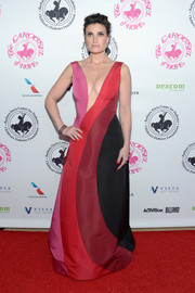 Idina Menzel caught admiring stares in a color-block gown with a cleavage-flaunting illusion neckline at the 2016 Carousel of Hope Ball.