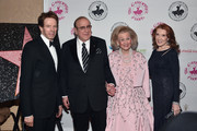 (L-R) Producer Jerry Bruckheimer, record producer Clive Davis, host Barbara Davis, and editor Linda Bruckheimer attend the 2016 Carousel Of Hope Ball at The Beverly Hilton Hotel on October 8, 2016 in Beverly Hills, California.