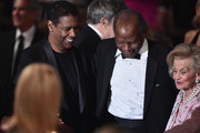 (L-R) Actor Denzel Washington, Inspirational Lifetime Achievement Award Recipient Sidney Poitier, and host Barbara Davis attend the 2016 Carousel Of Hope Ball at The Beverly Hilton Hotel on October 8, 2016 in Beverly Hills, California.