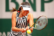 Ana Ivanovic of Serbia hits a backhand during the Ladies Singles second round match against Kurumi Nara of Japan on day five of the 2016 French Open at Roland Garros on May 26, 2016 in Paris, France.