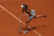 Ana Ivanovic of Serbia serves during the Ladies Singles third round match against Elina Svitolina of Ukraine on day seven of the 2016 French Open at Roland Garros on May 28, 2016 in Paris, France.