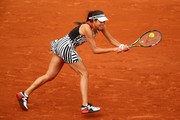 Ana Ivanovic of Serbia plays a backhand during the Women's Singles first round match against Oceane Dodin of France on day three of the 2016 French Open at Roland Garros on May 24, 2016 in Paris, France.