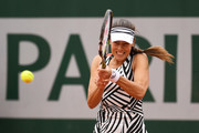 Ana Ivanovic of Serbia plays a backhand during the Ladies Singles first round match against Oceane Dodin of France on day three of the 2016 French Open at Roland Garros on May 24, 2016 in Paris, France.