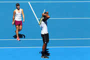 Nick Kyrgios of Australia Green partnered with Daria Gavrilova reacts after missing a shot in the mixed doubles match against Alexander Zverev and Sabine Lisicki of Germany during day one of the 2016 Hopman Cup at Perth Arena on January 3, 2016 in Perth, Australia.