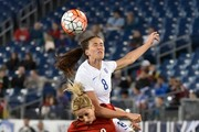 Jill Scott #8 of England and Kathrin Hendrich #8 of Germany jump for a ball during the second half of a friendly international match in the Shebelieves Cup at Nissan Stadium on March 6, 2016 in Nashville, Tennessee.