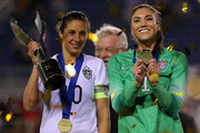 Hope Solo #1 and Carli Lloyd #10 of the United States celebrateafter winning a match against Germany in the 2016 SheBelieves Cup at FAU Stadium on March 9, 2016 in Boca Raton, Florida.