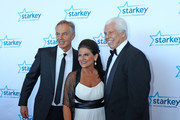 """Former Prime Minister Tony Blair, Tani Austin and Bill Austin pose on the red carpet at the 2016 Starkey Hearing Foundation """"So the World May Hear"""" awards gala at the St Paul RiverCentre on July 17, 2016 in St Paul, Minnesota."""