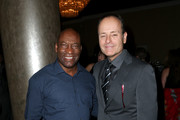 Filmmaker John Singleton (L) and President of FX John Landgraf attend the 32nd annual Television Critics Association Awards during the 2016 Television Critics Association Summer Tour at The Beverly Hilton Hotel on August 6, 2016 in Beverly Hills, California.