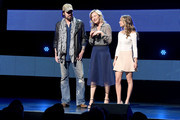 (L-R) Musician Billy Ray Cyrus, actor Joey Lauren Adams, and actor Madison Iseman speak onstage at the 2016 Viacom Kids and Family Group Upfront on March 3, 2016 in New York City.