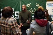 Jabari Parker of the Milwaukee Bucks and Bucks legend Michael Redd, along with mascot Bango, and members of the Milwaukee Bucks Dancers, interact with local families and assist volunteers with the distribution of Thanksgiving dinner baskets on November 21, 2017 at the House of Peace in Milwaukee, Wisconsin. NOTE TO USER:  User expressly acknowledges and agrees that, by downloading and or using this Photograph, user is consenting to the terms and conditions of the Getty Images License Agreement.  Mandatory Copyright Notice:  Copyright 2017 NBAE