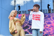 Bebe Rexha and Louis Tomlinson perform onstage during the Daytime Village Presented by Capital One at the 2017 HeartRadio Music Festival at the Las Vegas Village on September 23, 2017 in Las Vegas, Nevada.
