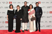 Managing Director of DIFF Shivani Pandya (L), actor Irrfan Khan (R) and guests attend the Opening Night Gala of the 14th annual Dubai International Film Festival held at the Madinat Jumeriah Complex on December 6, 2017 in Dubai, United Arab Emirates.