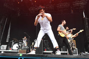 (L-R) Musicians Francois Comtois, Sameer Gadhia, Eric Cannata and Payam Doostzadeh of the band Young the Giant perform at the Hangout Stage during 2017 Hangout Music Festival on May 21, 2017 in Gulf Shores, Alabama.