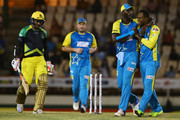 In this handout image provided by CPL T20, Marlon Samuels, Daren Sammy and Jesse Ryder of St Lucia Stars celebrate the dismissal of Kumar Sangakarra of the Jamaica Tallawahs during Match 14 of the 2017 Hero Caribbean Premier League between St Lucia Stars v Jamaica Tallawahs at the Darren Sammy  Stadium on August 15, 2017 in Gros Islet, Saint Lucia.