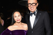 2017 Art+Film Gala Co-Chair Eva Chow, wearing Gucci, and CEO of Gucci Marco Bizzarri attend the 2017 LACMA Art + Film Gala Honoring Mark Bradford and George Lucas presented by Gucci at LACMA on November 4, 2017 in Los Angeles, California.