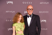 Petra Collins (L) and Chief Executive Officer, Gucci, Marco Bizzarri attend the 2017 LACMA Art + Film Gala Honoring Mark Bradford And George Lucas at LACMA on November 4, 2017 in Los Angeles, California.