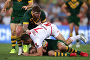 Cameron Smith of the Kangaroos is tackled by Luke Gale of England as Josh McGuire of the Kangaroos comes in for support during the 2017 Rugby League World Cup Final between the Australian Kangaroos and England at Suncorp Stadium on December 2, 2017 in Brisbane, Australia.