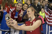 Becky Sauerbrunn #4 of the United States of America takes a selfie with fans after the match against Germany during the SheBelieves Cup at Talen Energy Stadium on March 1, 2017 in Chester, Pennsylvania. The United States defeated Germany 1-0.