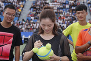 Li Na of China autographs on tennis ball for winners of the tennis game during a tennis clinic which is part of the Wuhan Open Project at 2017 Wuhan Open on September 28, 2017 in Wuhan, China.