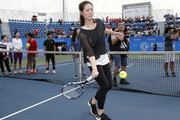 Li Na of China hits a tennis ball to spectators at a tennis clinic which is part of the Wuhan Open Project at 2017 Wuhan Open on September 28, 2017 in Wuhan, China.
