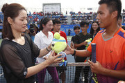 Li Na of China hands out souvenir to the winner of the tennis game during a tennis clinic which is part of the Wuhan Open Project at 2017 Wuhan Open on September 28, 2017 in Wuhan, China.