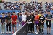 Li Na of China poses for a picture with students who particpated the tennis clinic at 2017 Wuhan Open on September 28, 2017 in Wuhan, China.