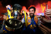 Josh Kennedy of the Eagles walks the Premiership Cup though their fans during the 2018 Toyota AFL Grand Final match between the West Coast Eagles and the Collingwood Magpies at the Melbourne Cricket Ground on September 29, 2018 in Melbourne, Australia.