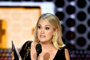 Carrie Underwood accepts Favorite Female Artist - Country onstage during the 2018 American Music Awards at Microsoft Theater on October 9, 2018 in Los Angeles, California.