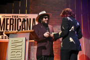 Don Was presents an award to Rosanne Cash during the 2018 Americana Music Honors and Awards at Ryman Auditorium on September 12, 2018 in Nashville, Tennessee.