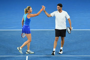 Alicia Molik (L) of Australia and Mark Philippoussis of Australia compete in their mixed doubles match against Goran Ivanisevic of Croatia and Daniela Hantuchova of Slovakia on day 10 of the 2018 Australian Open at Melbourne Park on January 24, 2018 in Melbourne, Australia.