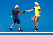 Lleyton Hewitt (L) of Australia and Sam Groth of Australia compete in their quarter-final match against Juan Sebastian Cabal of Colombia and Robert Farah of Colombia on day 10 of the 2018 Australian Open at Melbourne Park on January 24, 2018 in Melbourne, Australia.