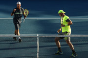 Lleyton Hewitt (L) of Australia and Sam Groth  of Australia compete in their first round men's doubles match against Denis Istomin of Uzbekistan and Mikhail Kukushkin of Kazakhstan on day four of the 2018 Australian Open at Melbourne Park on January 18, 2018 in Melbourne, Australia.
