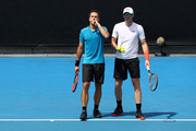 Bruno Soares of Brazil (L) and Jamie Murray of Great Britain .talk tactics in their second round men's doubles match against Leander Paes of India and Purav Raja of India on day six of the 2018 Australian Open at Melbourne Park on January 20, 2018 in Melbourne, Australia.
