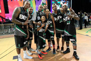 (L_R) Lecrae, Tank , Big Boy,Miles Brown, Christian Keyes, Brittney Elena, Chris Staples, and Larry 'Bone Collector' Williams pose at the Celebrity Basketball Game Sponsored By Sprite during the 2018 BET Experience at Los Angeles Convention Center on June 23, 2018 in Los Angeles, California.