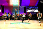(L-R) Lecrae, Kap G, Casanova, Doug Christie, Larry 'Bone Collector' Williams, Famous Dex, Chris Staples, and Tank play basketball at the Celebrity Basketball Game Sponsored By Sprite during the 2018 BET Experience at Los Angeles Convention Center on June 23, 2018 in Los Angeles, California.