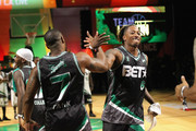 Tank (L) and Lecrae dap at the Celebrity Basketball Game Sponsored By Sprite during the 2018 BET Experience at Los Angeles Convention Center on June 23, 2018 in Los Angeles, California.
