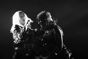 Image has been converted to black and.white.) Recording artists Christina Aguilera (L) and Demi Lovato perform onstage during the 2018 Billboard Music Awards at MGM Grand Garden Arena on May 20, 2018 in Las Vegas, Nevada.