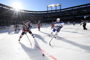 Kyle Okposo #21 of the Buffalo Sabres and Ryan McDonagh #27 of the New York Rangers vie for the puck in the corner during the first period of the 2018 Bridgestone NHL Winter Classic between the New York Rangers and the Buffalo Sabres at Citi Field on January 1, 2018 in the Flushing neighborhood of the Queens borough of New York City.