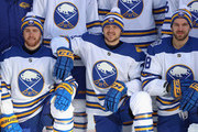 (L-R) Scott Wilson #20, Johan Larsson #22 and Zemgus Girgensons #28 of the Buffalo Sabres pose for a team practpractice at Citi Field on December 31, 2017 in the Flushing neighborhood of the Queens borough of New York City. The team will take part in the 2018 Bridgestone NHL Winter Classic on New Years Day.